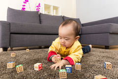 Chinese baby boy play toy block and lying on carpet Royalty Free Stock Photography