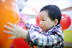 Chinese baby boy playing balloon at home Royalty Free Stock Photography