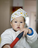 Chinese baby boy playing at a bed home Royalty Free Stock Photo