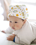 Chinese baby boy playing at a bed home Royalty Free Stock Photography