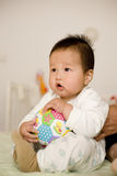 Chinese baby boy playing football at home Royalty Free Stock Image