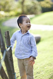 Chinese baby boy playing in the garden Royalty Free Stock Photography