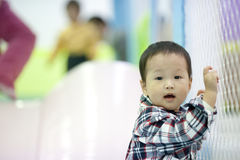 Chinese baby boy playing at a play ground Royalty Free Stock Photo