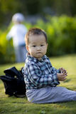 Chinese baby boy playing at a play ground Stock Photo