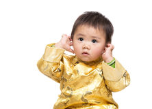 Chinese baby boy touch his ear Royalty Free Stock Images