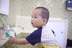 Chinese baby boy washing hand Royalty Free Stock Photos