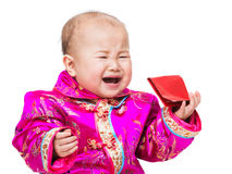 Chinese baby crying with red pocket Royalty Free Stock Photo