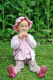 A chinese baby eating biscuit Stock Image