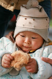 Chinese baby eating bread Stock Photography