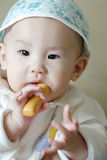 A chinese baby eating solid food Stock Photos