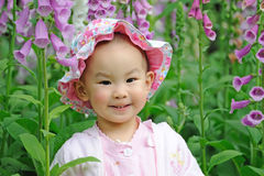 A chinese baby in the flowers Stock Image