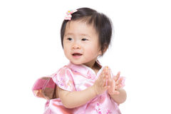 Chinese baby girl clapping hand Stock Photos