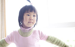 Chinese baby girl dancing at home Stock Photos