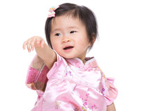 Chinese baby girl hand up and point to front Royalty Free Stock Photos