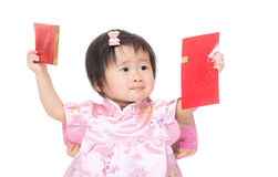 Chinese baby girl holding two red pocket Stock Image