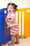 Chinese Baby Girl playing with balls Royalty Free Stock Image