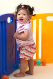 Chinese Baby Girl playing with balls Stock Image