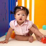 Chinese Baby Girl playing with balls Stock Photography