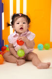 Chinese Baby Girl playing with balls Royalty Free Stock Photography