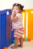Chinese Baby Girl playing with balls Stock Photos