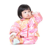 Chinese baby girl scratching hair Stock Photo