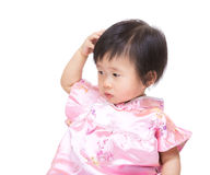 Chinese baby girl scratching head Stock Photos