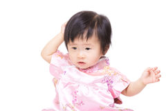 Chinese baby girl touch her hair Stock Images