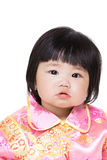 Chinese baby girl with traditional costume. Isolated on white royalty free stock photos