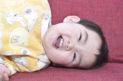 A chinese baby is laughing. Happily Royalty Free Stock Photos