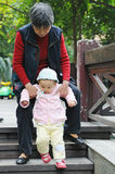 Chinese baby learn to walk Stock Photo
