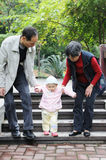 Chinese baby learn to walk Stock Photography