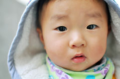 A Chinese baby looking at camera Royalty Free Stock Photo