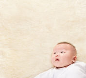 Chinese baby looking up to empty space Stock Photos