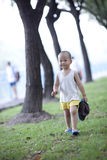 Chinese baby playing on the grassland Royalty Free Stock Photos