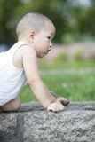 Chinese baby playing on the grassland Royalty Free Stock Images