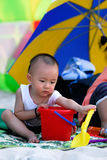 Chinese baby playing sand. A beautiful little baby playing sand Stock Photography