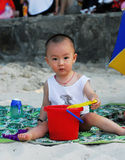 Chinese baby playing sand. A beautiful little baby playing sand Stock Photos