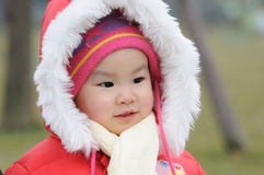 Chinese baby with red hat Royalty Free Stock Photography