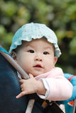 Chinese baby sitting in stroller Royalty Free Stock Photos