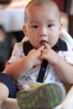 Chinese baby sucking finger Royalty Free Stock Photo