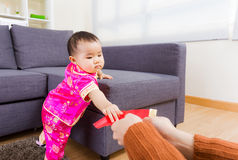 Chinese baby taking red pocket from adult Stock Photography