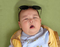 Chinese baby wearing sunglasses Stock Images