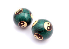 Chinese balls. Green Chinese balls for relaxation on white background Stock Photos