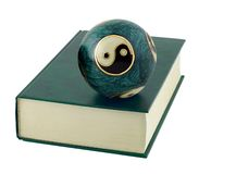 Chinese balls in book cover. Zen-like chinese balls in book cover isolated on white background royalty free stock photos