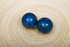 Chinese balls for relaxation of spirit and body. On wooden plate Stock Images