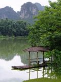 Chinese bamboo boat with mountain scene Royalty Free Stock Image