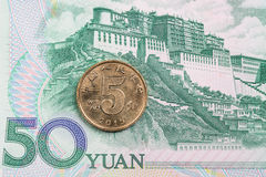 Chinese banknotes and coin Royalty Free Stock Image