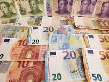 Chinese banknotes and euro bills. China, cny, yuan, europe, european, commerce, exchange, travel, trade, trading, value, buy, sell, profit, price, rate, cash stock photo