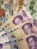 Chinese banknotes and euro bills. China, cny, yuan, europe, european, commerce, exchange, travel, trade, trading, value, buy, sell, profit, price, rate, cash royalty free stock photos