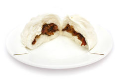 Chinese Barbecued Pork Bun (Cha Siu Baau). A Chinese barbecued pork bun tear into two half stock images